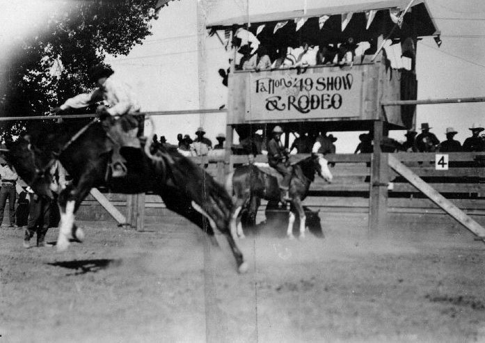 Black-and-white photo of a rodeo event.