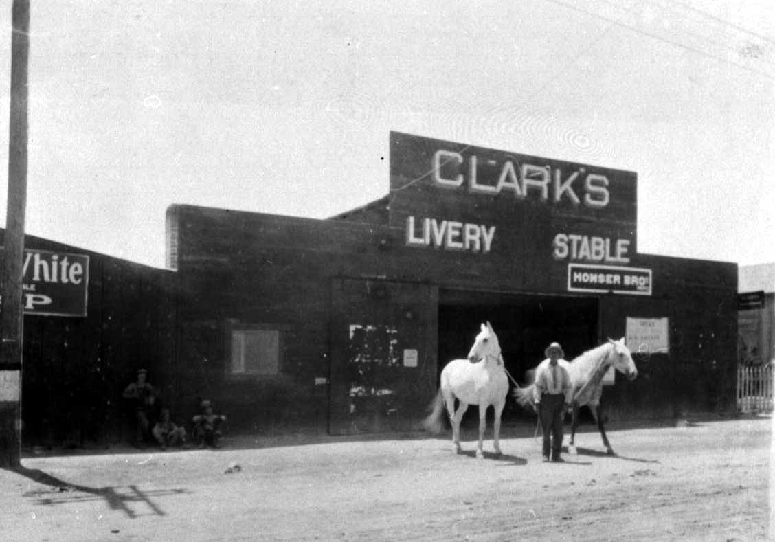 Black-and-white photo of Clark's Livery Stable.
