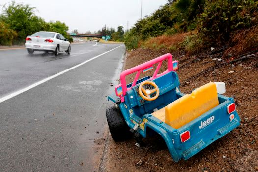 Abandoned toy Jeep on side of highway