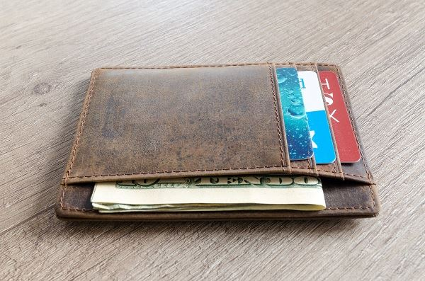 Brown Leather Wallet and Us Dollar Banknote